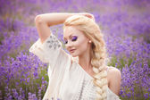 Romantic portrait of beautiful woman on the lavender field — Foto Stock