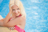 Beautiful and sexy blonde women in pool — Stock Photo
