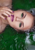 Attractive woman in water with glamor make-up — Stock Photo