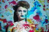 Creative portrait, fashion woman with color image on her face — Stock Photo