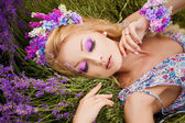 Romantic portrait of beautiful woman on the lavender field — Stock Photo