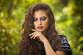 Beautiful indian woman with curly hair in blue dress — Stock Photo