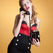 Beautiful young girl with a vintage telephone survey in retro style — Stock Photo #8064611