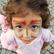 Little Girl With Face Paint Looking Up — Stock Photo