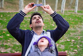 Father And Daughter Taking Photographs — Stock Photo