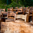 Royalty-Free Stock Photo: Empty Wooden Chairs and Tables