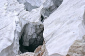 Deep crack in the glacier in the mountains — Stock Photo