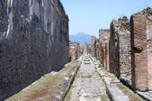 Street in Pompeii ruins near volcano Vesuvius, Italy — Stock Photo