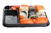 Sushi på svart plåt — Stockfoto