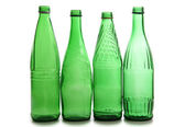 Green bottles wineglasses — Stock Photo
