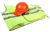 Hard hat and vest — Stock Photo