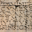 Ancient latin inscription on an old stone. — Stock Photo