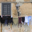 Stock Photo: Washed clothes drying in sun.