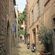 Old narrow street in medieval a city  — Stock Photo