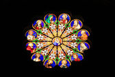 Stained-glass window in ancient Italy church — Stock Photo