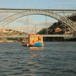 Porto (Oporto). Ancient town in Portugal. Old boat on the Douro river. — Stock Photo #44277099