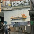 Porto (Oporto). Ancient town in Portugal. Old boat on the Douro river. — Stock Photo #44277177