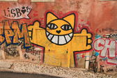 Splendid graffiti on wall of the building in Lisbon. — Stock Photo