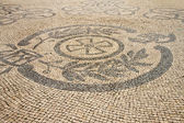 Traditional marble mosaic on street in Lisbon (Portugal) — Stockfoto
