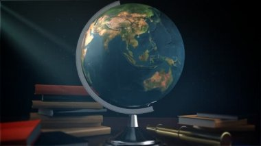 Spinning globe with books — Stockvideo