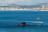 Submarine arriving at port — Stock Photo