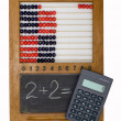 Children's scores, blackboard, chalk, a calculator — Stock Photo