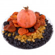 Pomegranate, raisins, dried apricots, prunes on a plate - Stock Photo