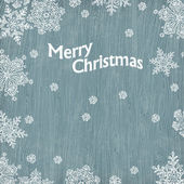 Christmas greetings with snowflakes on wooden texture. Vector il — Stock Vector