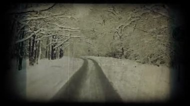 Winter road, vintage styled shot. — Stock Video