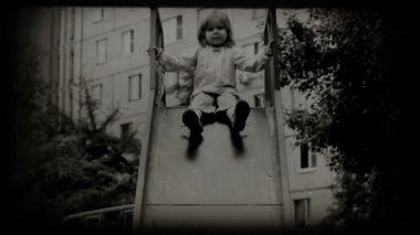 Children spending time in playground slide — Stock Video