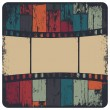 Film strip in grunge frame on colorful seamless wooden backgroun — Stock Vector