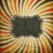 Grunge colorful rays background with vintage label for text. — Stock Photo