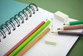Lápis, borracha, caderno — Foto Stock