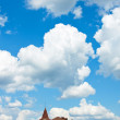 House on a background sky with clouds — Stock Photo