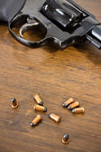 Revolver and bullets — Stock Photo