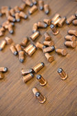 Bullets on wood background — Stock Photo