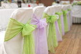 Wedding chairs with silk ribbon — Stock Photo
