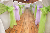 Wedding chairs with silk ribbons — Stock Photo