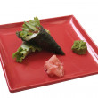 Hand rolled ikuro temaki — Stock Photo