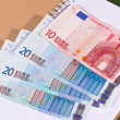 Euro money in notebook — Stockfoto