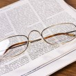 Stock Photo: Glasses on newspaper