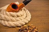 Tobacco-pipe in rope,and tobacco — Stock Photo