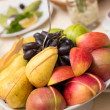 Fruits in dish — Stock Photo