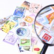 Stamp under magnifier — Stock Photo