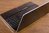 Laptop on table — Stock Photo