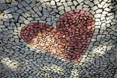 Heart shaped pebble pavement — Stock Photo