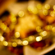 Golden lights at night. Beautiful blurred background. — Stock Photo