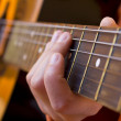 Playing the guitar — Stock Photo