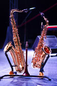 Two saxophones on stage — Stock Photo