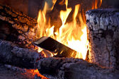 Fire wood burns in a fireplace — Stock Photo